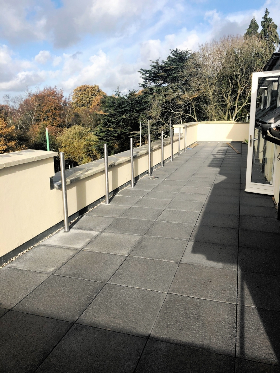 paved roof terrace area surrey