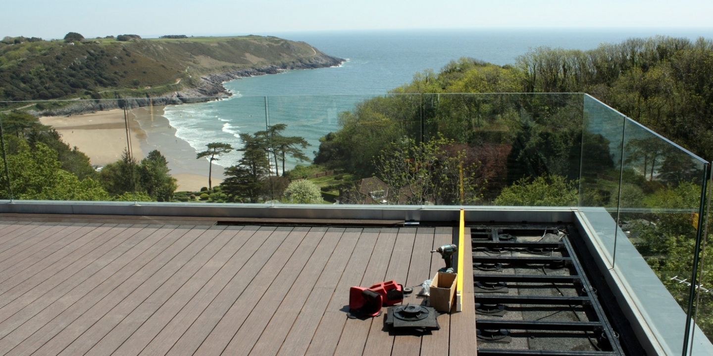 wood grain composite deck boards supported by decking cradles on roof terrace
