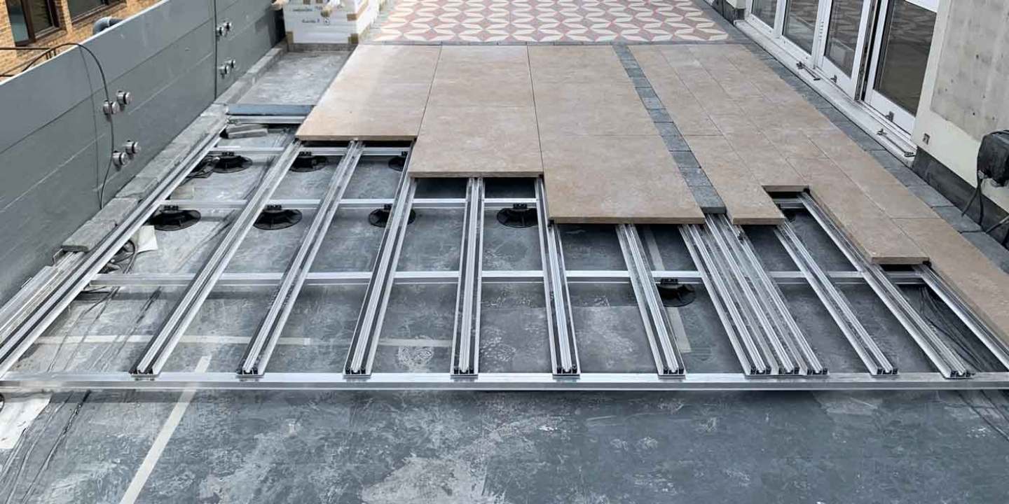 Ryno pave rail aluminium paving support system with slabs on roof terrace
