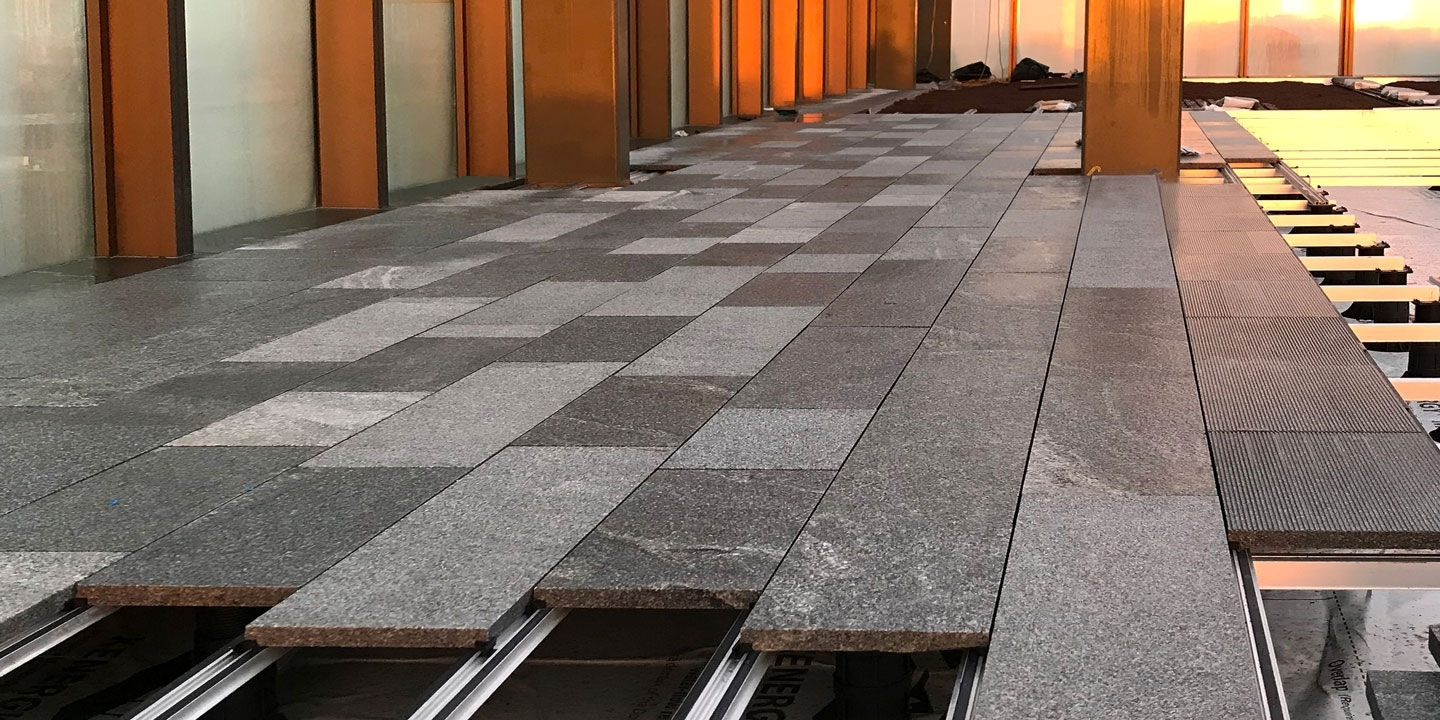 roof terrace with granite slabs supported by ryno paverail substructure