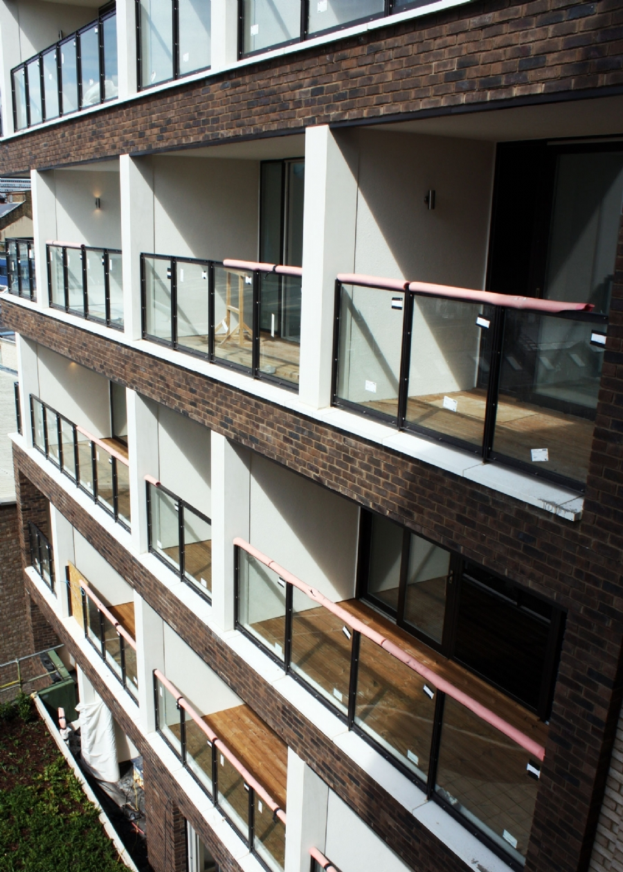 thermowood decking across multiple residential balcony spaces