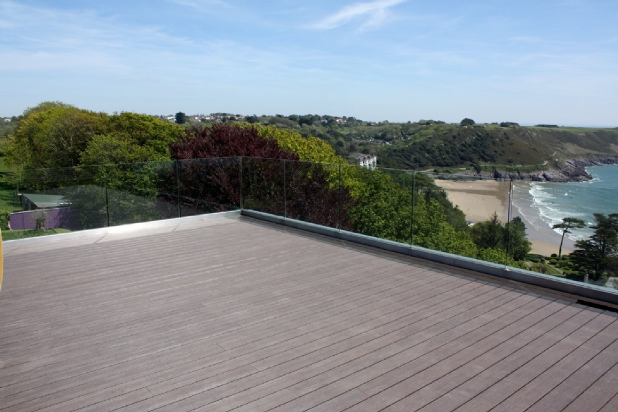 brown ryno composite decking board with views out over wales