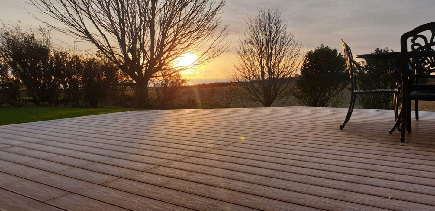 composite decking in the morning frost in aberdeenshire domestic garden